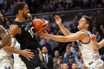 Butler forward Bryce Nze (10) and Villanova guard Collin Gillespie (2) grapple for a rebound during the second half of an NCAA college basketball game, Tuesday, Jan. 21, 2020, in Villanova, Pa. Villanova won 76-61. (AP Photo/Laurence Kesterson)