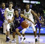 Kansas State guard Kamau Stokes (3) and Baylor forward Flo Thamba (0) watch the ball in the second half of an NCAA college basketball game, Saturday, Feb. 9, 2019, in Waco, Texas. (Rod Aydelotte/Waco Tribune Herald, via AP)
