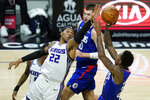 Sacramento Kings center Richaun Holmes (22) defends against Los Angeles Clippers guard Lou Williams, right, during the second quarter of an NBA basketball game Wednesday, Jan. 20, 2021, in Los Angeles. (AP Photo/Ashley Landis)