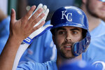 Kansas City Royals' Whit Merrifield celebrates in the dugout after hitting a solo home run during the eighth inning of a baseball game against the Baltimore Orioles, Sunday, Sept. 1, 2019, in Kansas City, Mo. (AP Photo/Charlie Riedel)