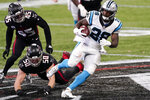 Carolina Panthers running back Mike Davis (28) runs after a ctach against the Atlanta Falcons during the first half of an NFL football game, Sunday, Oct. 11, 2020, in Atlanta. (AP Photo/John Bazemore)
