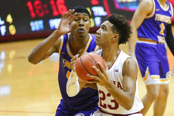 Indiana's Trayce Jackson-Davis (23) goes to the basket against dTennessee Tech's Marcus Hopkins during the first half of an NCAA college basketball game, Wednesday, Nov. 25, 2020, in Bloomington, Ind. (AP Photo/Darron Cummings)