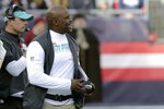 Miami Dolphins head coach Brian Flores works along the sideline in the first half of an NFL football game against the New England Patriots, Sunday, Dec. 29, 2019, in Foxborough, Mass. (AP Photo/Charles Krupa)