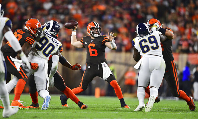 Cleveland Browns quarterback Baker Mayfield (6) looks to throw during the first half of an NFL football game against the Los Angeles Rams, Sunday, Sept. 22, 2019, in Cleveland. (AP Photo/David Dermer)