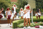 Oklahoma Pom Squad members Piper Tucker and Annie Rose pose for a photo outside of Gaylord Family-Oklahoma Memorial Stadium before an NCAA college football game between Oklahoma and Missouri State in Norman, Okla., on Saturday, Sept. 12, 2020. (Ian Maule/Tulsa World via AP)