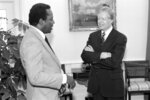 FILE - In this April 30, 1980 file photo, Mayor Richard Hatcher of Gary, Ind., chairman of the Conference of Black Mayors, meets with President Jimmy Carter at the White House in Washington. On Friday, Dec. 13, 2019, Hatcher, who became one of the first black mayors of a big U.S. city when he was elected in 1967, died. He was 86. (AP Photo)