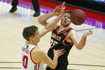 Idaho State center Brayden Parker (25) and Utah forward Mikael Jantunen (20) battle for a rebound during the first half of an NCAA college basketball game Tuesday, Dec. 8, 2020, in Salt Lake City. (AP Photo/Rick Bowmer)