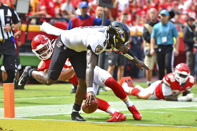 Baltimore Ravens quarterback Lamar Jackson (8) scores a touchdown in front of Kansas City Chiefs safety Daniel Sorensen (49) during the second half of an NFL football game in Kansas City, Mo., Sunday, Sept. 22, 2019. (AP Photo/Ed Zurga)