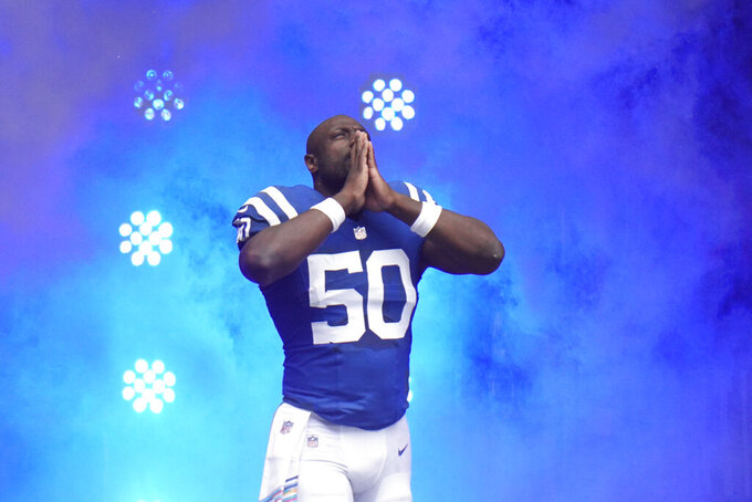 Indianapolis Colts defensive end Justin Houston is introduced before an NFL football game against the Cincinnati Bengals, Sunday, Oct. 18, 2020, in Indianapolis. (AP Photo/AJ Mast)