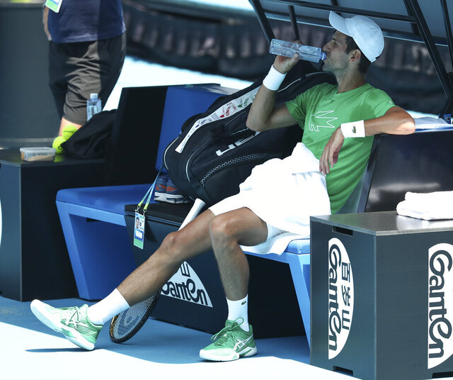 Serbia's Novak Djokovic takes a drink during a practice session ahead of the Australian Open tennis championship in Melbourne, Australia, Sunday, Jan. 19, 2020. (AP Photo/Dita Alangkara)