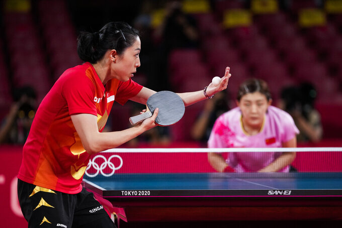 Singapore's Yu Mengyu serves against China's Chen Meng during the table tennis women's singles semifinal at the 2020 Summer Olympics, Thursday, July 29, 2021, in Tokyo. (AP Photo/Kin Cheung)
