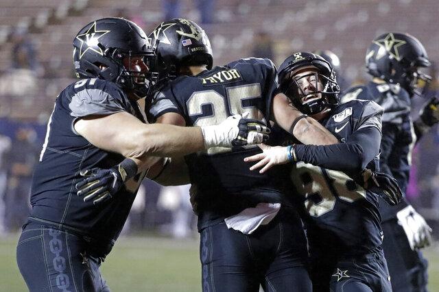 Vanderbilt running back Mitchell Pryor (25) celebrates with Drew Birchmeier, left, and Ryley Guay, right, after Pryor ran 31 yards for a touchdown against ETSU in the second half of an NCAA college football game Saturday, Nov. 23, 2019, in Nashville, Tenn. Vanderbilt won 38-0. (AP Photo/Mark Humphrey)