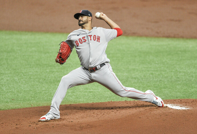 Boston Red Sox starter Martin Perez pitches against the Tampa Bay Rays during the first inning of a baseball game Wednesday, Aug. 5, 2020, in St. Petersburg, Fla. (AP Photo/Steve Nesius)