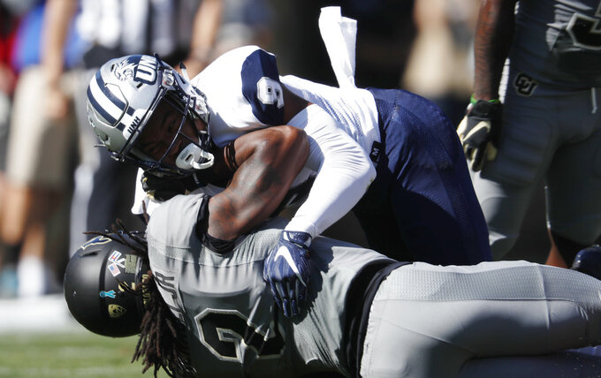 New Hampshire cornerback Isiah Perkins, top, tackles Colorado wide receiver Laviska Shenault Jr. after a short gain in the first half of an NCAA college football game Saturday, Sept. 15, 2018, in Boulder, Colo. (AP Photo/David Zalubowski)