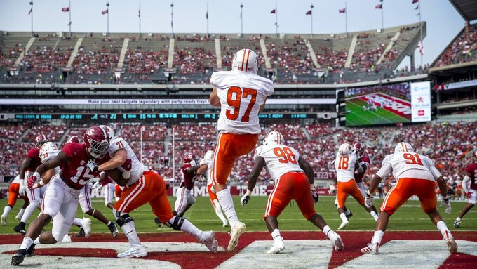 Mercer punter/kicker Trey Turk (97) punts out of his own end zone as Alabama linebacker Dallas Turner (15) adds pressure during the first half of an NCAA college football game, Saturday, Sept. 11, 2021, in Tuscaloosa, Ala. (AP Photo/Vasha Hunt)