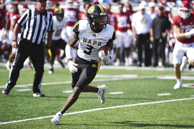 Pine Bluff receiver Josh Wilkes (3) runs the ball against Arkansas during the first half of an NCAA college football game Saturday, Oct. 23, 2021, in Little Rock, Ark. (AP Photo/Michael Woods)
