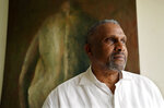 Tavis Smiley, owner of progressive talk radio station KBLA Los Angeles (1580), poses for a portrait in his station's offices, Tuesday, June 15, 2021, in Los Angeles.(AP Photo/Chris Pizzello)