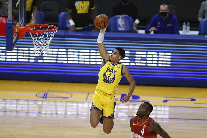 Golden State Warriors' Jordan Poole, left, shoots against Denver Nuggets' Paul Millsap at an NBA basketball game in San Francisco, Friday, April 23, 2021. (AP Photo/Jed Jacobsohn)