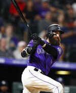 Colorado Rockies' Charlie Blackmon watches his two-run triple off San Diego Padres starting pitcher Matt Wisler during the seventh inning of a baseball game Thursday, June 13, 2019, in Denver. (AP Photo/David Zalubowski)