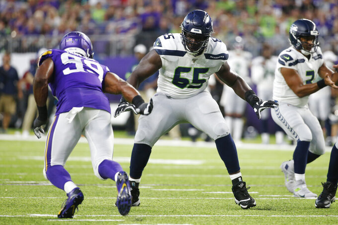 FILE - In this Aug. 18, 2019, file photo, Seattle Seahawks offensive tackle Germain Ifedi (65) looks to block Minnesota Vikings defensive end Danielle Hunter, left, during the first half of an NFL preseason football game in Minneapolis. The Chicago Bears finalized a one-year deal with Ifedi on Wednesday, April 1, 2020. (AP Photo/Bruce Kluckhohn, File)