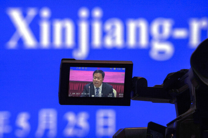 Xu Guixiang, a spokesperson for the Xinjiang northwestern region's government, speaks during a press conference related to Xinjiang issues at the Xinjiang Tower in Beijing, Tuesday, May 25, 2021. China on Tuesday denounced a people's tribunal planned for the UK over allegations of genocide being committed against Uyghurs and other Turkic Muslim people in the Xinjiang region. (AP Photo/Andy Wong)
