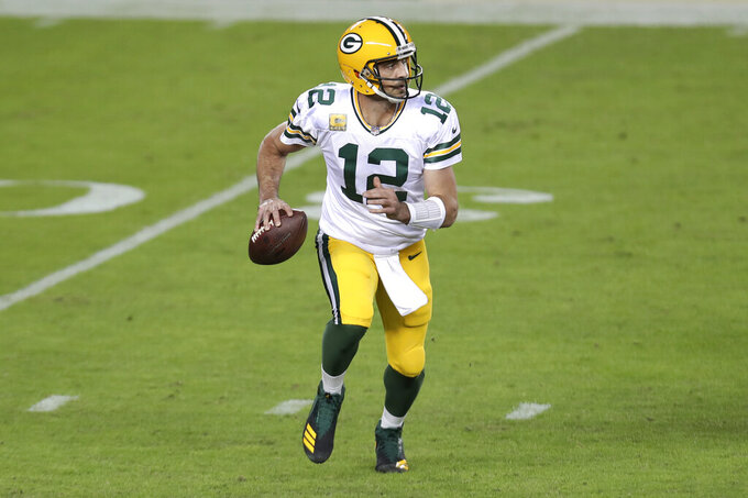 Green Bay Packers quarterback Aaron Rodgers (12) rolls out to pass against the San Francisco 49ers during the first half of an NFL football game in Santa Clara, Calif., Thursday, Nov. 5, 2020. (AP Photo/Jed Jacobsohn)