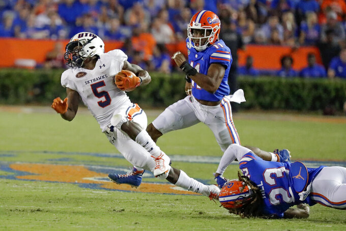UT Martin running back Jaimiee Bowe (5) is stopped by Florida defensive back Jaydon Hill (23) and linebacker Mohamoud Diabate, center, during the second half of an NCAA college football game Saturday, Sept. 7, 2019, in Gainesville, Fla. (AP Photo/John Raoux)