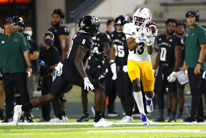 While being guarded by Hawaii defensive back Eugene Ford (8), San Jose State wide receiver Jermaine Braddock (13) can't pull in a pass during the second half of an NCAA college football game, Saturday, Sept. 18, 2021, in Honolulu. (AP Photo/Marco Garcia)