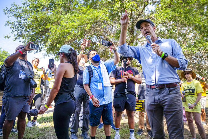 Former Democratic congressman and presidential candidate Beto O'Rourke speaks to the crowd during a break on the march with his voter outreach organization Powered by People are partnering with Rev. William Barber and the Poor People's Campaign as they gathered together on the side of the road in Round Rock, Texas to participate in a Selma-style march for democracy from Georgetown, Texas to the Texas State Capitol in downtown Austin. On Wednesday, July 28, 2021 the group made a stop at Good Hope church in Round Rock and will end with a rally at the Capitol at 10 am on July 31st. (Ricardo B. Brazziell/Austin American-Statesman via AP)
