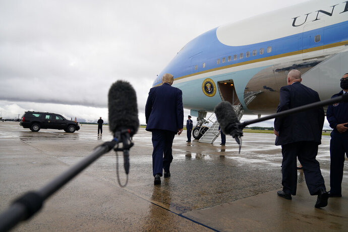 FILE - In this Sept. 10, 2020, file photo President Donald Trump boards Air Force One for a trip to a campaign rally in Freeland, Mich., in Andrews Air Force Base, Md. (AP Photo/Evan Vucci, File)