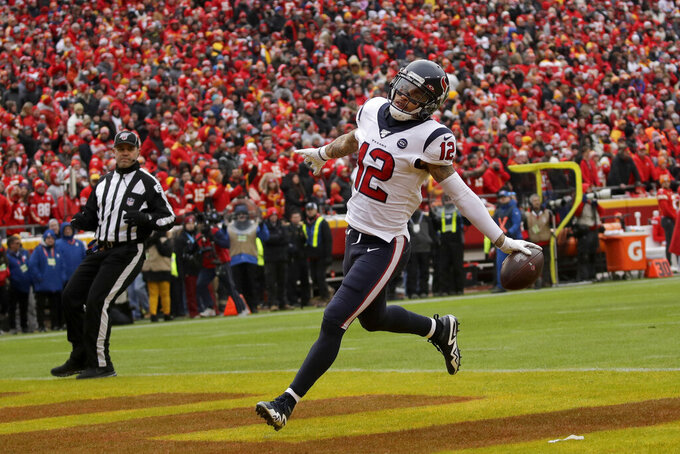 Houston Texans wide receiver Kenny Stills (12) scores a touchdown during the first half of an NFL divisional playoff football game against the Kansas City Chiefs, in Kansas City, Mo., Sunday, Jan. 12, 2020. (AP Photo/Charlie Riedel)