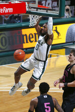 Michigan State's Aaron Henry (0) dunks against Penn State's John Harrar, right, and Jamari Wheeler (5) during the second half of an NCAA college basketball game, Tuesday, Feb. 9, 2021, in East Lansing, Mich. Michigan State won 60-58. (AP Photo/Al Goldis)