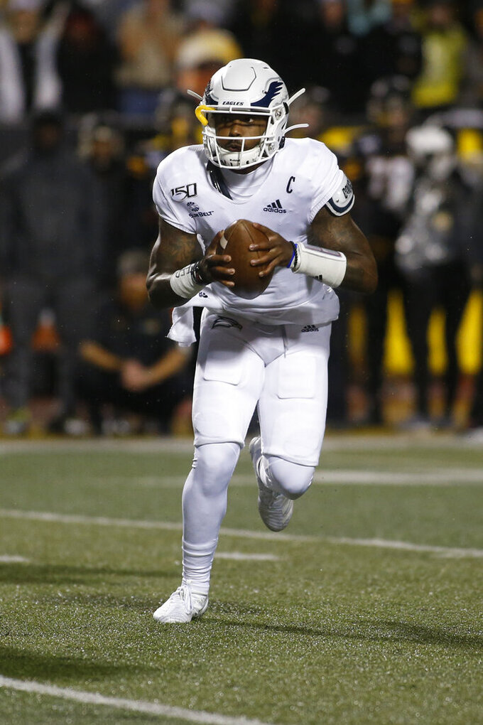 Georgia Southern quarterback Shai Werts (1) looks for an open receiver during the first half of the team's NCAA college football game against Appalachian State on Thursday, Oct. 31, 2019, in Boone, N.C. (AP Photo/Brian Blanco)