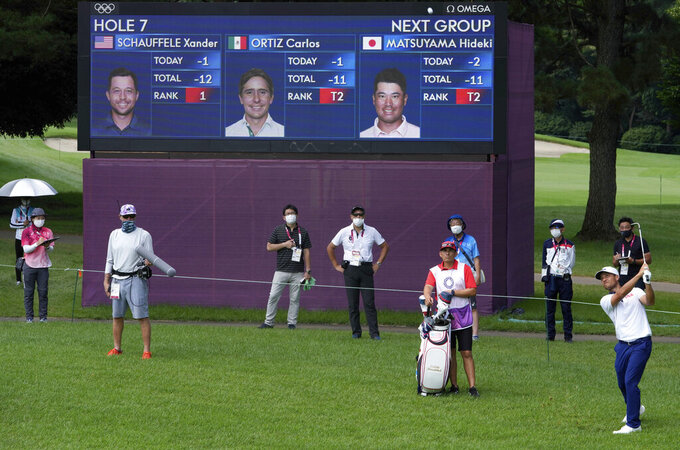 Xander Shauffele of United States chips onto the 7th green during the third round of the men's golf event at the 2020 Summer Olympics on Saturday, July 31, 2021, in Kawagoe, Japan. (AP Photo/Andy Wong)
