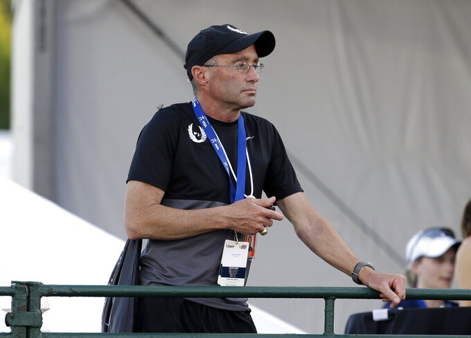 FILE - In this June 25, 2015, file photo, Alberto Salazar watches a race at the U.S. track and field championships in Eugene, Ore. Track coach Salazar received no relief from the Court of Arbitration for Sport, which upheld his four-year ban for a series of doping-related violations that had long been pursued by American regulators. A person familiar with the decision told The Associated Press on Wednesday, Sept. 15, 2021, that the bans for both Salazar and endocrinologist Jeffrey Brown, first passed down in 2019, had been upheld. The person did not want to be identified because CAS has not yet released the full report, which is expected soon. (AP Photo/Don Ryan, File)