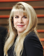 "FILE - Singer Stevie Nicks attends the 2014 Vanity Fair Oscar Party in West Hollywood, Calif., on March 2, 2014, Nicks has spent the last 10 months homebound, mainly due to the coronavirus pandemic. During that time, she recorded the new single ""Show Them the Way"
