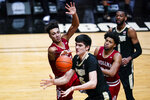 Purdue center Zach Edey (15) is fouled as he grabs a rebound by Indiana forward Trayce Jackson-Davis (23) during the second half of an NCAA college basketball game in West Lafayette, Ind., Saturday, March 6, 2021.  (AP Photo/Michael Conroy)