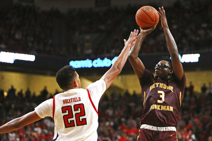 Bethune-Cookman's Wali Parks (3) shoots the ball over Texas Tech's TJ Holyfield (22) during the first half of an NCAA college basketball game Saturday, Nov. 9, 2019, in Lubbock, Texas. (Sam Grenadier/Lubbock Avalanche-Journal via AP)