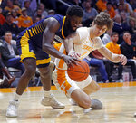 Tennessee forward Drew Pember (3) battles with Chattanooga guard David Jean-Baptiste (3) for the ball during the first half of an NCAA college basketball game Monday, Nov. 25, 2019, in Knoxville, Tenn. (AP Photo/Wade Payne)