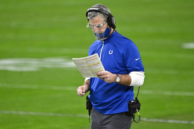 Indianapolis Colts head coach Frank Reich is seen during the second half of an NFL football game against the Las Vegas Raiders, Sunday, Dec. 13, 2020, in Las Vegas. (AP Photo/David Becker)
