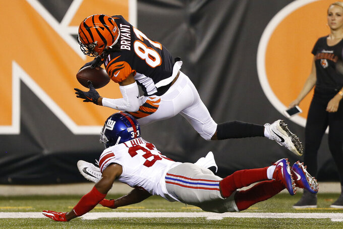 Cincinnati Bengals wide receiver Ventell Bryant (81) is tackled by New York Giants safety Kenny Ladler (33) during the second half of an NFL preseason football game Thursday, Aug. 22, 2019, in Cincinnati. (AP Photo/Gary Landers)