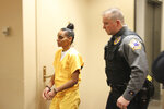 Gina Virgilio is shown being led back into the courtroom Monday, Oct. 14, 2019, in Anchorage, Alaska. Virgilio will serve 60 years in prison for killing her boyfriend, Michael Gonzalez, in 2012 by setting the couch fire to the couch on which he was sleeping. (AP Photo/Mark Thiessen)