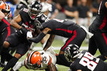 Atlanta Falcons running back Qadree Ollison (30) runs against the Cleveland Browns during the first half of a preseason NFL football game, Sunday, Aug. 29, 2021, in Atlanta. (AP Photo/Brynn Anderson)