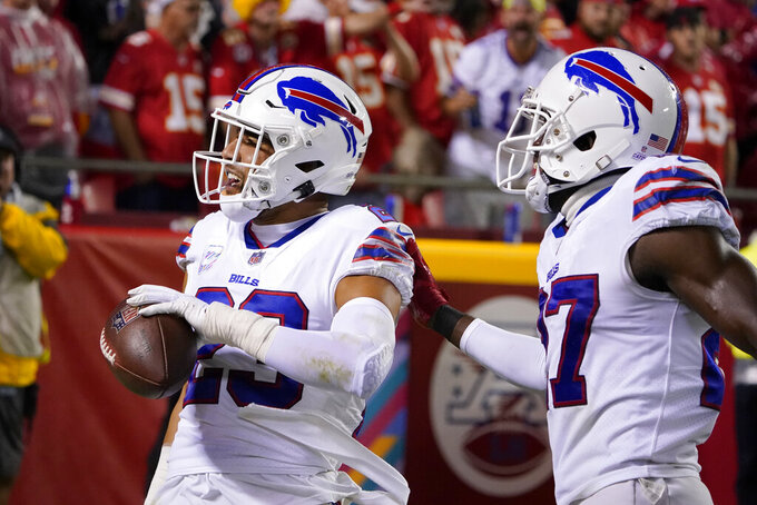 Buffalo Bills safety Micah Hyde, left, is congratulated by cornerback Tre'Davious White after running an interception back for a touchdown during the second half of an NFL football game against the Kansas City Chiefs Sunday, Oct. 10, 2021, in Kansas City, Mo. (AP Photo/Ed Zurga)