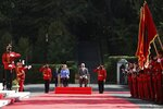 Albanian Prime Minister Edi Rama, right, and the German Chancellor Angela Merkel join the welcome ceremony at the Palace of Brigades in Tirana, Albania, Tuesday, Sept. 14, 2021. Merkel is on a farewell tour of the Western Balkans, as she announced in 2018 that she wouldn't seek a fifth term as Germany's Chancellor. (AP Photo/Franc Zhurda)