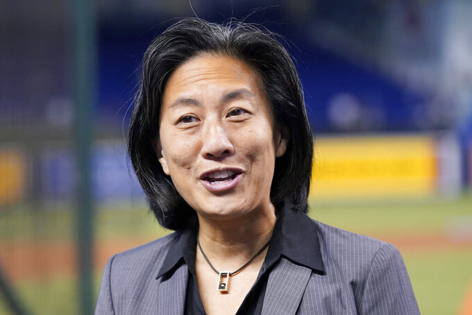 FILE - Miami Marlins General Manager Kim Ng talks with the media before a baseball game against the New York Yankees in Miami, in this Friday, July 30, 2021, file photo. Kim Ng, the first female general manager in baseball with the Miami Marlins, received the Billie Jean King Leadership Award at the Annual Salute to Women in Sports on Wednesday night, Oct. 13, 2021, in New York(AP Photo/Lynne Sladky, File)