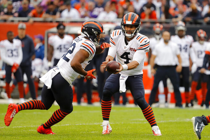 Chicago Bears quarterback Chase Daniel (4) hands off to running back David Montgomery during the half of an NFL football game against the Minnesota Vikings Sunday, Sept. 29, 2019, in Chicago. (AP Photo/Jeff Roberson)