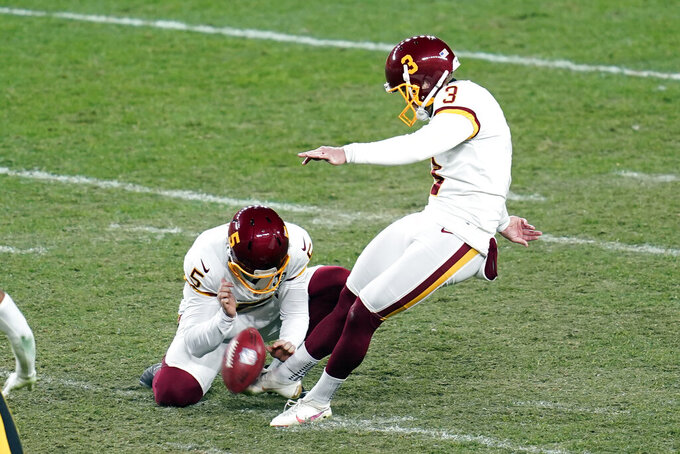 Washington Football Team kicker Dustin Hopkins (3) makes a 45-yard field goal during the second half of an NFL football game against the Pittsburgh Steelers, Monday, Dec. 7, 2020, in Pittsburgh. (AP Photo/Keith Srakocic)