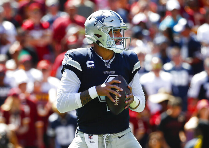 Dallas Cowboys quarterback Dak Prescott looks downfield to pass the ball in the first half of an NFL football game against the Washington Redskins, Sunday, Sept. 15, 2019, in Landover, Md. (AP Photo/Alex Brandon)