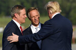 FILE-In this Monday, Oct. 1, 2018 file photo, President Donald Trump, left, talks with Tennessee Gov. Bill Haslam, center, and GOP gubernatorial candidate Bill Lee, left, after arriving at Tri-Cities Airport in Blountville, Tenn. Trump was in Tennessee to speak at a rally in Johnson City. This was one of this year's top stories in Tennessee. (AP Photo/Susan Walsh, File)